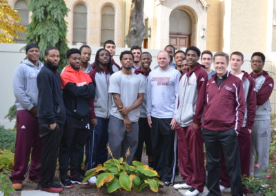 Fr. Kevin Scalf, C.PP.S., (far right) with a group of athletes and coaches from Calumet College of St. Joseph in Whiting, Ind.