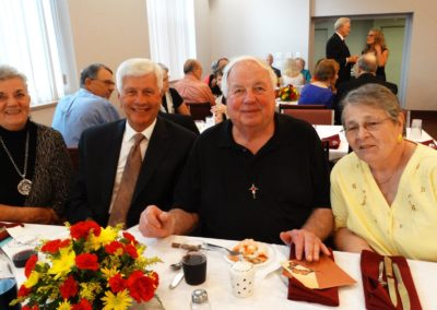 Fr. Al Naseman, C.PP.S., at the anniversary celebration with family members.