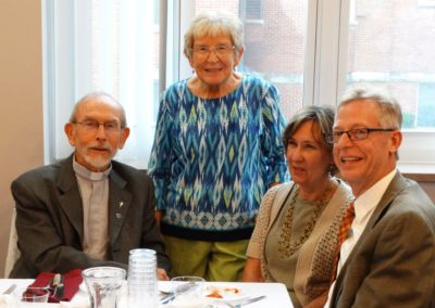 "Fr. Jim ""Santiago"" Gaynor, C.PP.S., at the anniversary celebration with family members."