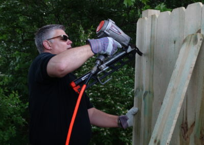 Fr. Vince Wirtner, C.PP.S., volunteers at a Habitat for Humanity site in Dayton.