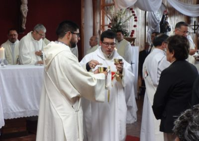 Fr. Diego gives communion at the ordination Mass.
