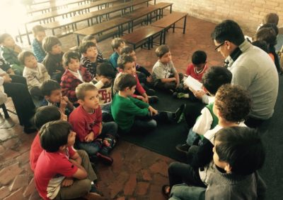 Fr. Angelmiro Granados, C.PP.S., reads to school children in Colombia.