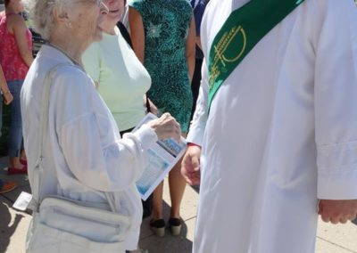 Deacon Matthew Keller, C.PP.S., talks with his Great-Aunt Rita Keller after Mass at St. John the Baptist.