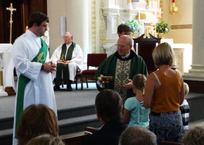 Deacon Matthew Keller, C.PP.S., and Fr. Gene Schnipke, C.PP.S., accept the gifts at offertory.