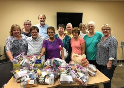 Companions (lay associates) of Lake Mary, Fla., making supply bags for the homeless.
