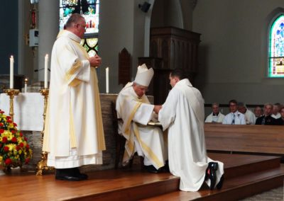 James Smith, C.PP.S., about to be ordained a priest, pledges obedience to the Church during the ordination rite.