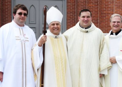 From left, Missionaries of the Precious Blood Deacon Matthew Keller, Bishop Joseph Charron, Fr. Jim Smith and Fr. Larry J Hemmelgarn, provincial director.