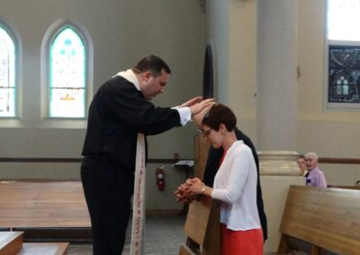 Fr. Jim Smith, C.PP.S., offers first blessings after the ordination Mass at St. Henry Church.