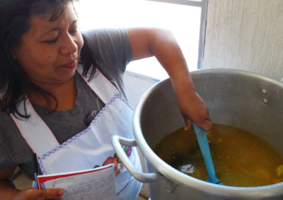 A volunteer cook prepares lunch at the nutrition project in La Labor, Guatemala.