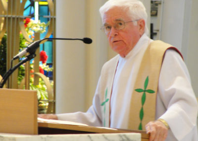 Fr. Andy O'Reilly, C.PP.S., preaches at St. Charles Center.