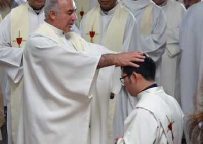 Fr. Miguel Soto, C.PP.S., lays hands on Diego.