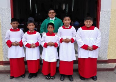 Fr. Felipe Caal Coy, C.PP.S., with altar servers after Mass.