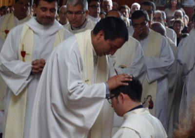 Fr. Jorge Gomez, C.PP.S., lays hands on Diego.