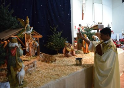 Fr. Frankline Rayappa, C.PP.S., blesses the nativity set at St. Edward, Newark, Calif.