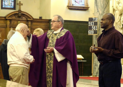 Fr. Ken Pleiman, C.PP.S., distributes ashes at St. Joseph Church, Dayton.