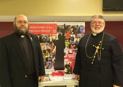 Br. Tim Cahill, C.PP.S., and Fr. Steve Dos Santos, C.PP.S., at a vocations fair.
