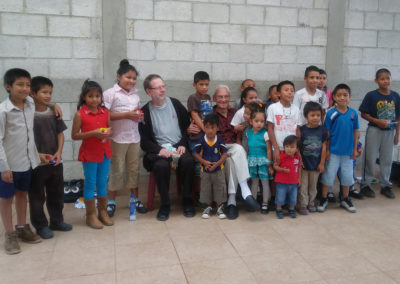 Brother Jerry Schwieterman, C.PP.S., and Fr. Bill Beuth, C.PP.S., wth children at the nutrition project in La Labor, Guatemala.