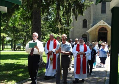 Bro. Terry Nufer, C.PP.S. leads the procession during the dedication of the Healing Place.