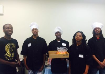 PBMR youth serve as chefs at a fundraising event.