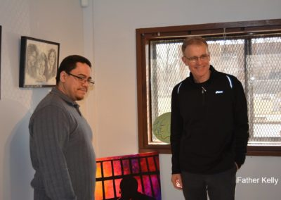 Fr. Dave Kelly, C.PP.S., right, at a PBMR art show.
