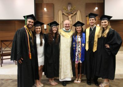 Fr. Ben Berinti, C.PP.S., with graduates at UCF's senior Mass.