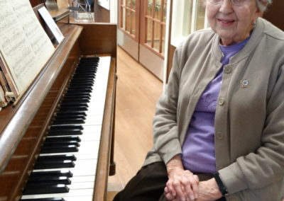 Companion Eileen Webber plays the piano for residents of Briarwood Village in Coldwater, Ohio, during Mass.