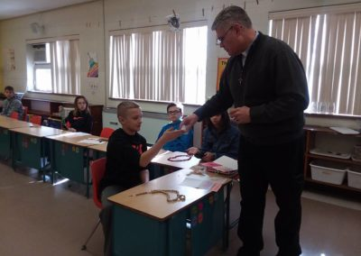 Fr. Vince Wirtner, C.PP.S., giving a presentation to a class at IC school, Celina, Ohio.