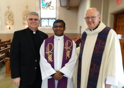 Posing with their visitor, Fr. Nuthulapati Jayababu, C.PP.S., at IC Church in Celina, Ohio, are Frs. Vince Wirtner (left) and Ken Schnipke (right).