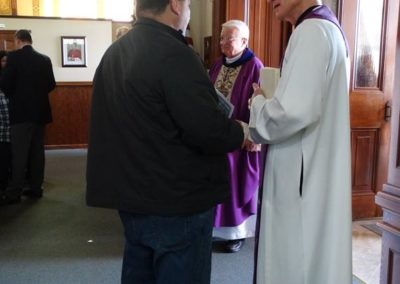Fr. Dave Kelly, C.PP.S., of the Precious Blood Ministry of Reconciliation, greets parishioners after Mass at St. John the Baptist Church in Maria Stein, Ohio. Behind him is Fr. Tom Brenberger, C.PP.S., associate pastor.