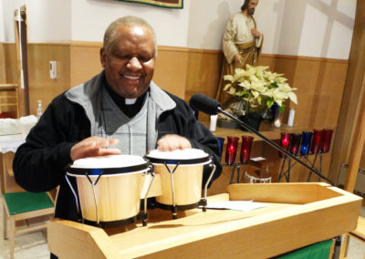 Fr. Alfons Minja, C.PP.S., with drums that were gifts from parishioners.