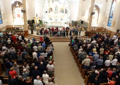 Everybody on their feet and singing/worshiping God during the parish's mission, Awaken.