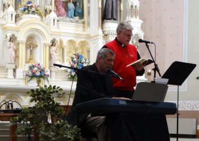 Fr. Vince Wirtner, C.PP.S., sings a prelude to Mass with Vince Ambrosetti during the parish's mission, Awaken.