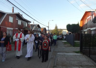 Fr. Omar Cerda Pacheco, C.PP.S., leads a procession during Stations of the Cross in Chile.