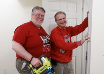 C.PP.S. Frs. Steve Dos Santos, left, and Larry J Hemmelgarn trim out doors in Mission of Mary's newly renovated offices.