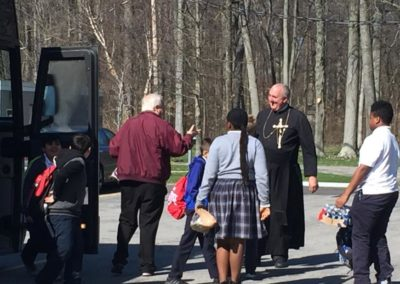Fr. Scott Kramer, C.PP.S., greets Br. Tom Bohman, C.PP.S., and approximately 50 students from St. James the Less Catholic School, Columbus, who spent the day in prayer and service.