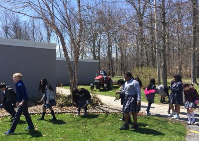 Approximately 50 students from St. James the Less Catholic School, Columbus, assisted in cleaning up the shrine. Fr. Scott Kramer, C.PP.S., followed on the tractor with trailer.
