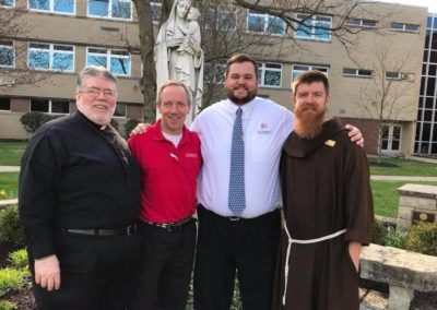 Fr. Steve Dos Santos, C.PP.S. (left) with fellow Vocation Directors, speaking to the young men at Moeller HIgh School in Cincinnati about their lives as priests and brothers.