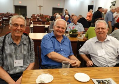 Three C.PP.S. brothers at the social following Evening Prayer: from left, Brs. James Ballmann, Tom Bohman and Joseph Fisher