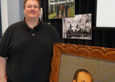 Fr. Kirch with a portrait of St. Gaspar, our founder.