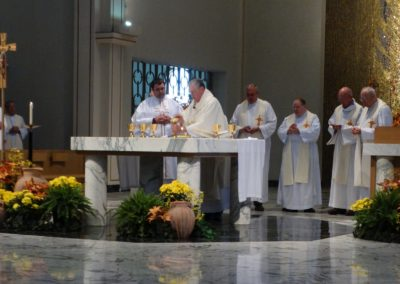 Fr. Ken Schroeder, C.PP.S., presides at Mass in Assumption Chapel on Wednesday.