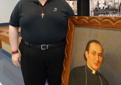 Fr. Steve Dos Santos C.PP.S., elected third councilor, with a portrait of St. Gaspar, our founder.