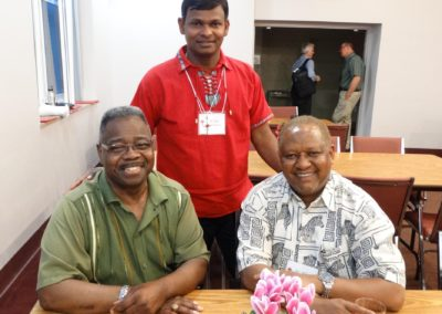 From left, C.PP.S. Frs. Clarence Williams, Nuthulapati Jayababu and Alfons Minja at the reception following the liturgy.