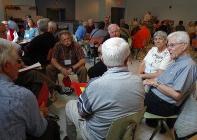 Members and Companions meet in small group to discuss the New Creation.