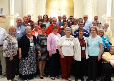Companions who made or renewed their covenants pose with C.PP.S. members after the liturgy in Assumption Chapel.