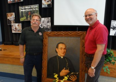 New provincial councilors Fr. Tim McFarland, C.PP.S., left, and Fr. Ben Berinti, C.PP.S., with a portrait of our founder, St. Gaspar.