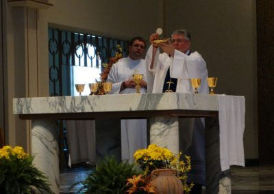 Fr. Steve Dos Santos C.PP.S., presides at Mass at the assembly on Thursday, the Feast of Mary Help of Christians, a patroness of the Congregation. Deacon Matthew Keller, C.PP.S., is at left.