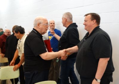 Fr. Charles Mullen, C.PP.S., congratulates Fr. Jeff Kirch, C.PP.S.