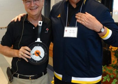 Fr. Larry Hemmelgarn, C.PP.S., who is completing his second term as provincial director, receives a gift of a soccer hat and kitchen clock from the Colombian mission, represented by Fr. Joe Deardorff, C.PP.S., right, director of the mission.
