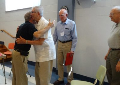 Fr. Larry Hemmelgarn, C.PP.S., is congratulated by members (C.PP.S. Frs. Jim Dugal, Jim Franck and John Menscik) as his term nears its end.