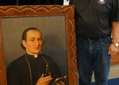 Br. Tom Bohman, C.PP.S., with a portrait of our founder, St. Gaspar.